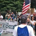 Protestors participate in a march against vaccine mandates around New York City Hall in Manhattan on Aug. 9, 2021. (Enrico Trigoso/The Epoch Times)